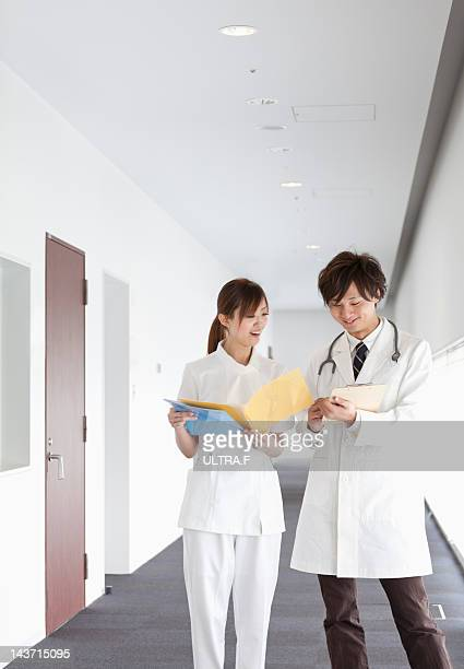Doctor and nurse talking