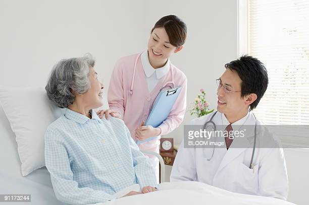 Doctor and nurse talking with patient