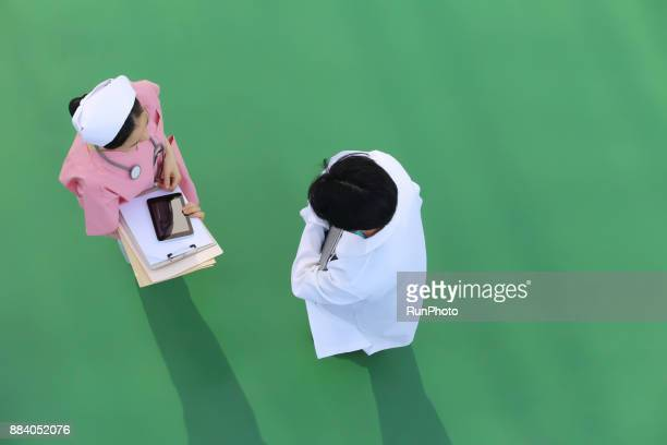 Doctor and nurse, top view