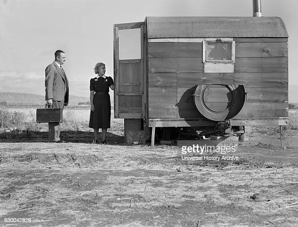 Doctor and Nurse Visiting Sick Child in Mobile Home at Farm Security Administration Mobile Camp Merrill Klamath County Oregon USA Dorothea Lange for...