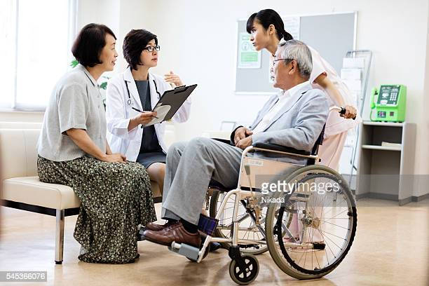 Doctor and nurse with senior couple in hospital