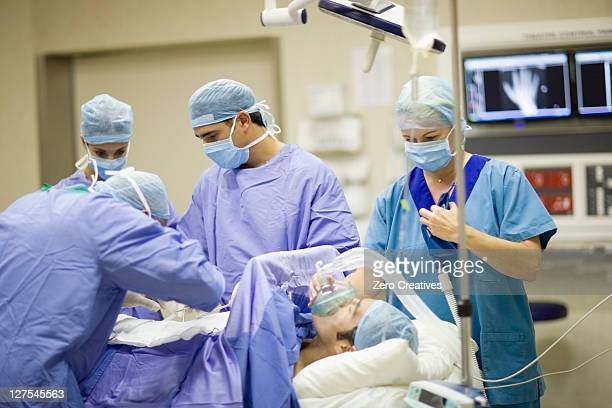 Doctor and nurses performing operation