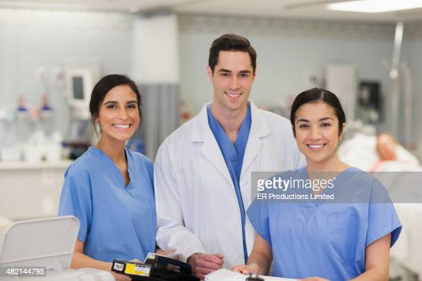 Doctor and nurses smiling in hospital