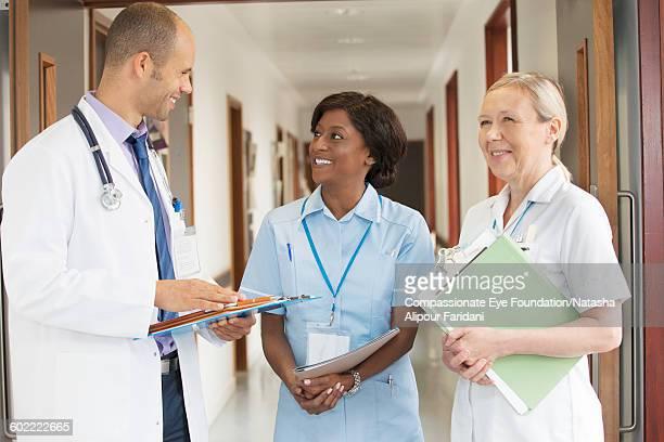Doctor and nurses talking in hospital corridor