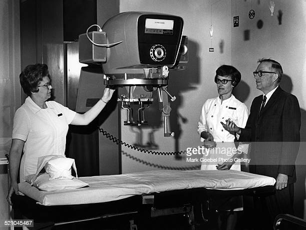 Doctor and nurses with xray machine late 1960s