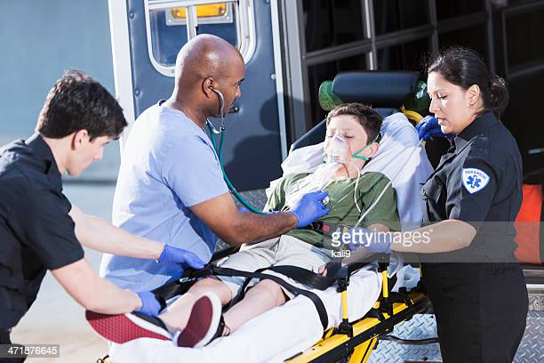 Doctor and paramedics helping child