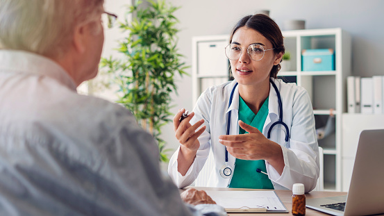 Doctor and patient are discussing at clinic 1022803838