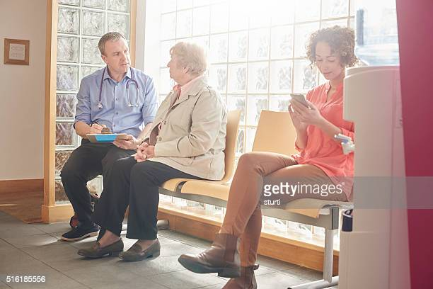 doctor and patient chatting informally