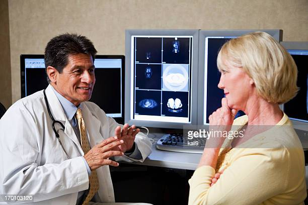 Doctor and patient discussing medical scans