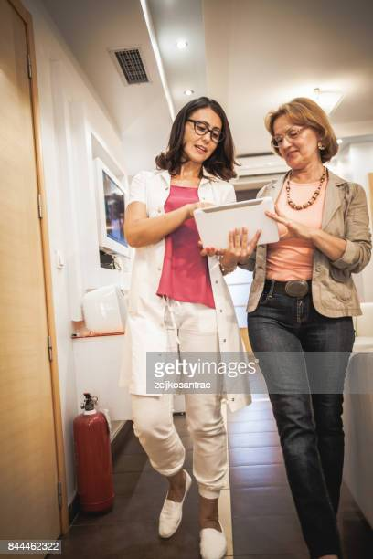 doctor and patient discussing - patience stock pictures, royalty-free photos & images