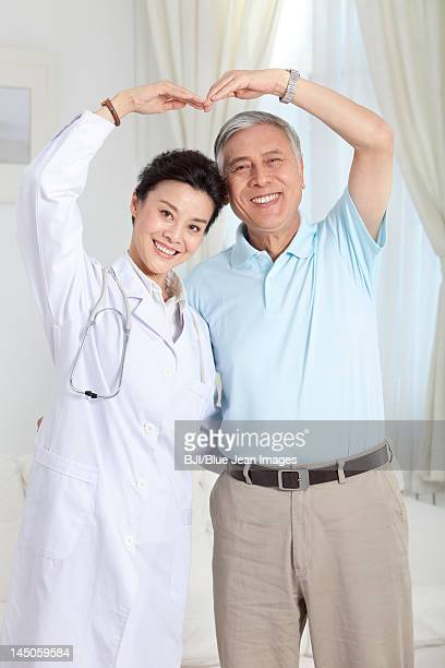 Doctor and patient doing a heart shape gesture
