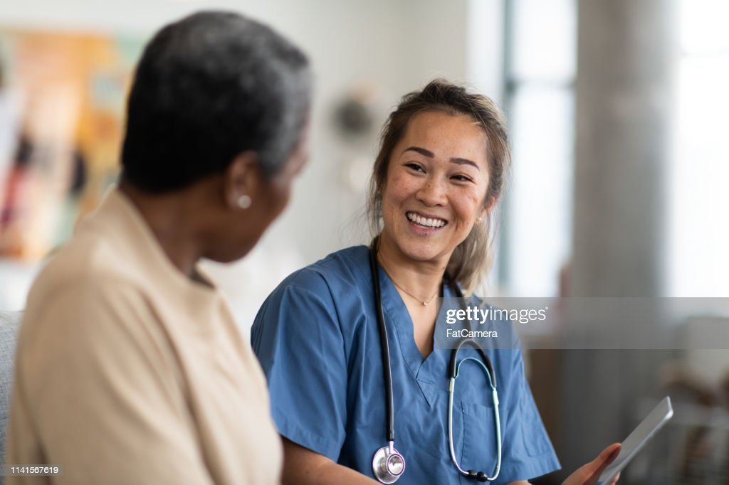 Doctor and patient having a conversation : Stock Photo