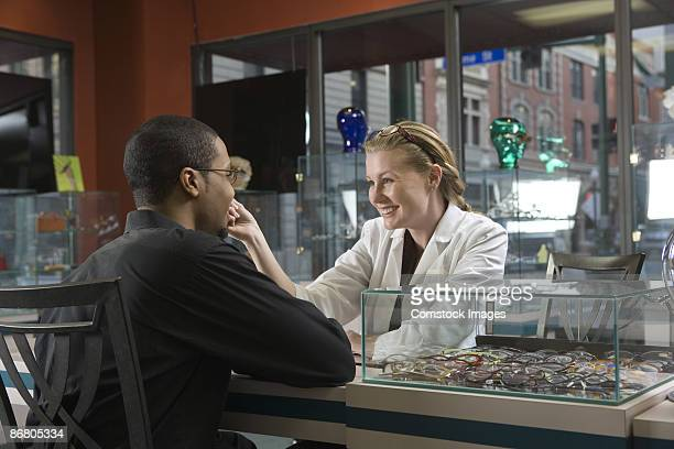 Doctor and patient in eyeglasses store