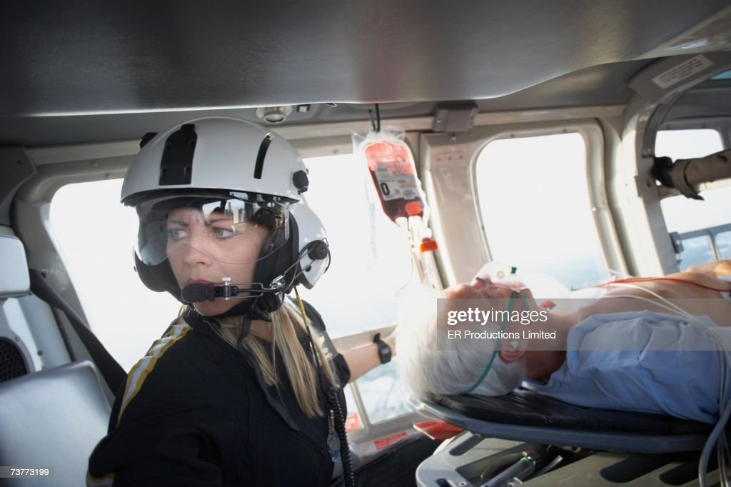 Doctor and patient in medical helicopter : Stock Photo