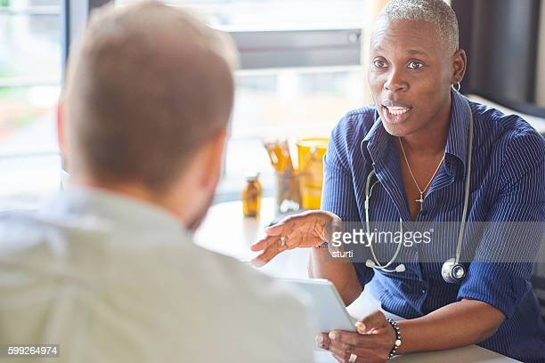 doctor and patient - androgynous stock pictures, royalty-free photos & images