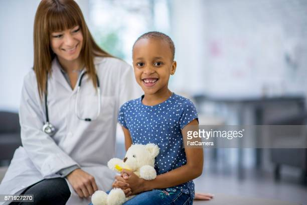 doctor and patient - bald girl stock photos and pictures