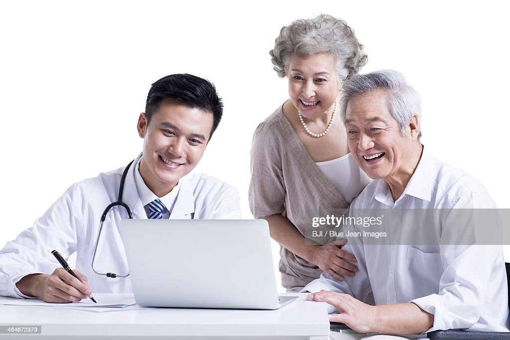 Doctor and patient seeing the results on laptop : Stock Photo