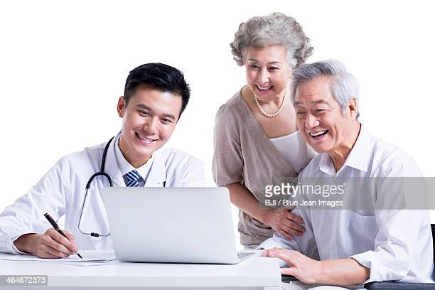 Doctor and patient seeing the results on laptop