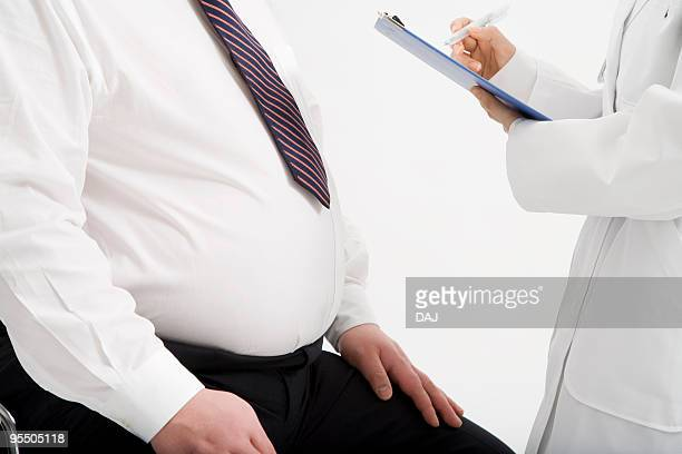 doctor and patient talking - metabolic syndrome stock pictures, royalty-free photos & images