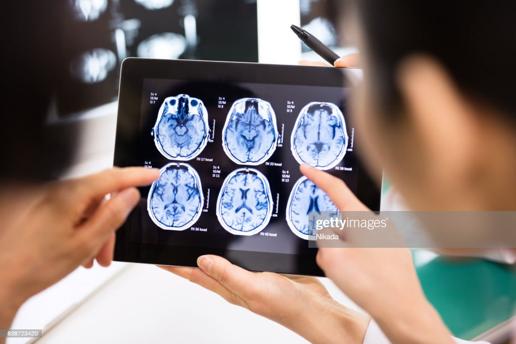 Doctor and patient using digital tablet in hospital : Stock Photo