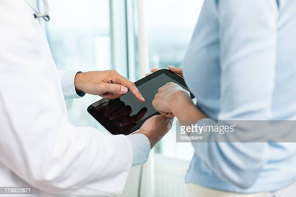 Doctor and patient with digital tablet