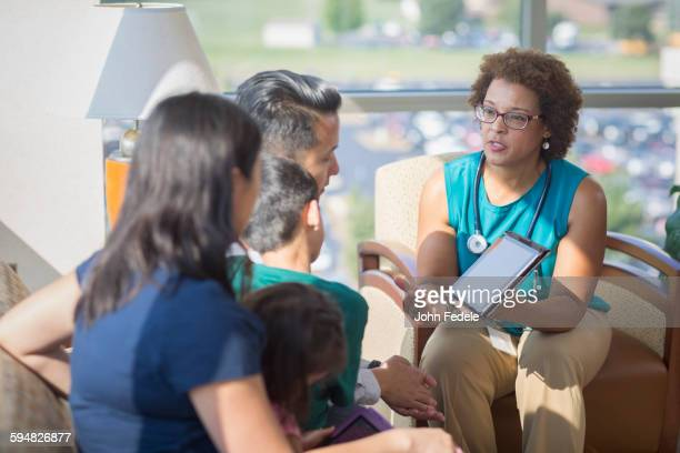 doctor and patients using digital tablet - patients brothers stock pictures, royalty-free photos & images