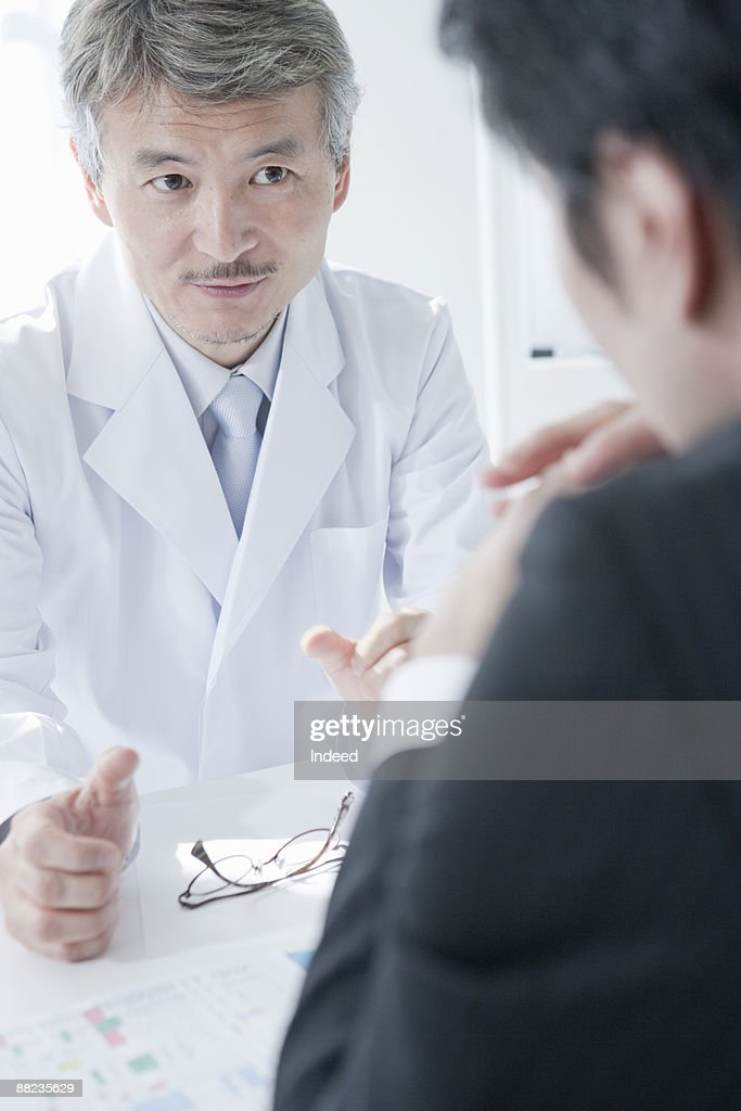 Doctor And Pharmaceutical Rep Talking At Table Stock Photo Getty