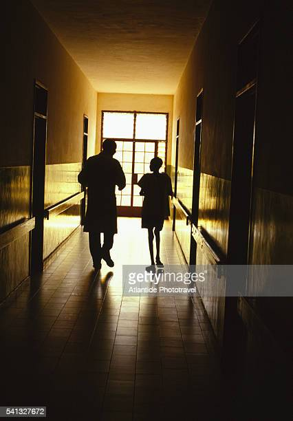 Doctor and TB Patient in Hallway