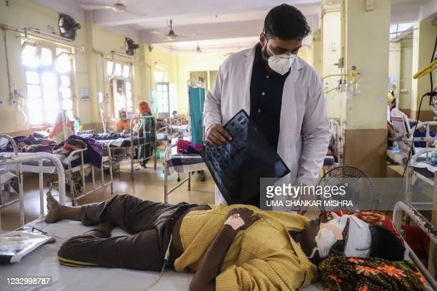 Doctor assists a Covid-19 coronavirus patient with Black Fungus, a deadly and rare fungal infection, as he receives treatments at the NSCB hospital...