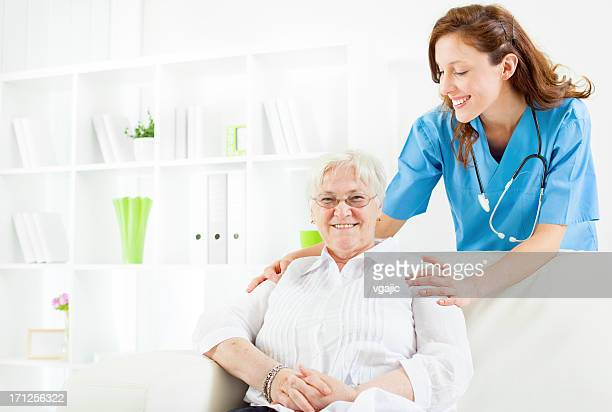 Doctor at home visit to Senior Woman.