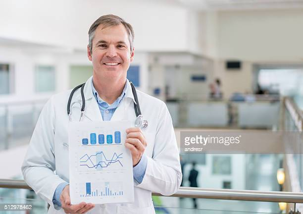 Doctor at the hospital holding statistics document
