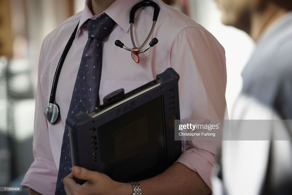 A doctor at The Queen Elizabeth Hospital Birmingham does his rounds on the wards on June 14, 2006 in Birmingham, England. Senior managers of the NHS have said that the organisation needs to become more open in the future.
