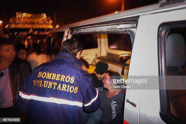 A doctor attends to a grieving mother whose daughter was shot and killed on a bus January 16 2014 in Guatemala City Guatemala The bomberos...