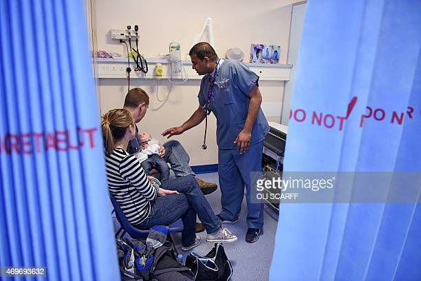 A doctor attends to a young patient in the specialist Children's Accident and Emergency department of the 'Royal Albert Edward Infirmary' in Wigan...