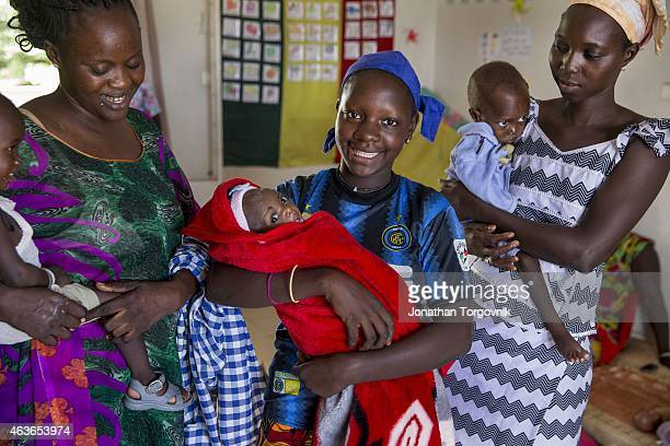 A doctor attends to malnourished children at the Kaolack central hospital The mothers that come with their malnourished children also receive...