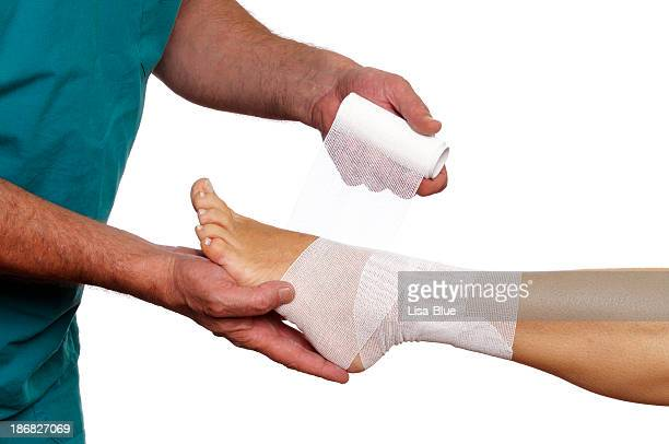 Doctor Bandaging Woman Ankle
