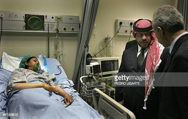 A doctor briefs Jordan's King Abdullah II about the medical condition of a victim of an suicide attack in Jordan hospital 11 November 2005 Fifty...
