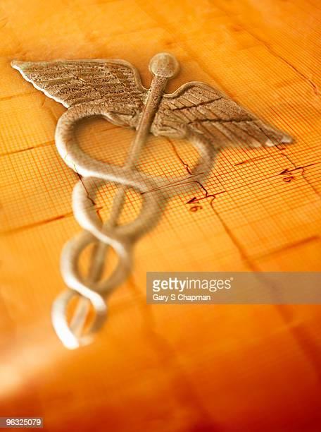 Doctor caduceus on healthy EKG readout