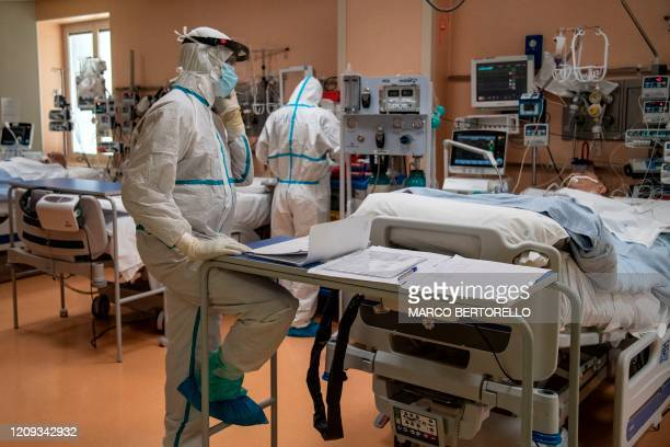 A doctor calls relatives of a patient to update them on a patient in intensive care in the COVID ward of the Maria Pia Hospital in Turin on April 7...