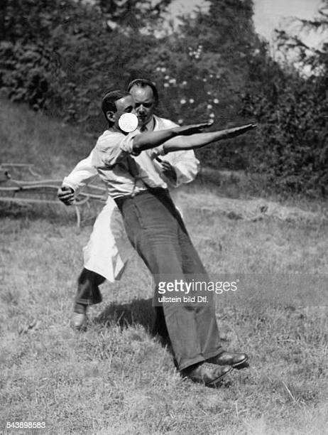 A doctor catching a hypnotised man 1930 Photographer Weltrundschau Neudin Published by 'BZ' 26/1930Vintage property of ullstein bild