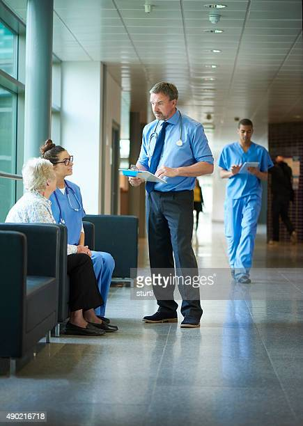 doctor chatting to a patient on the hospital corridor.