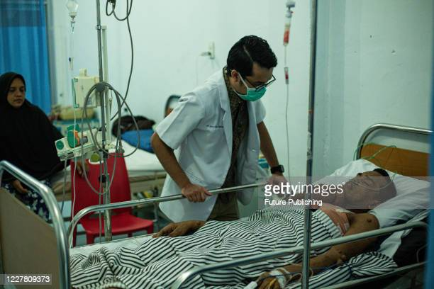 Doctor check Andriadi Putra after surgery at Accu Plast Hospital, in Medan, North Sumatra. A MAN who was living with 30 kilograms of tumours hanging...