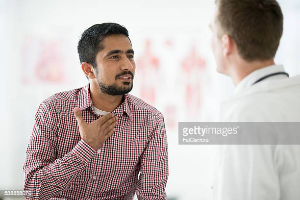 Doctor Checking a Man Cough