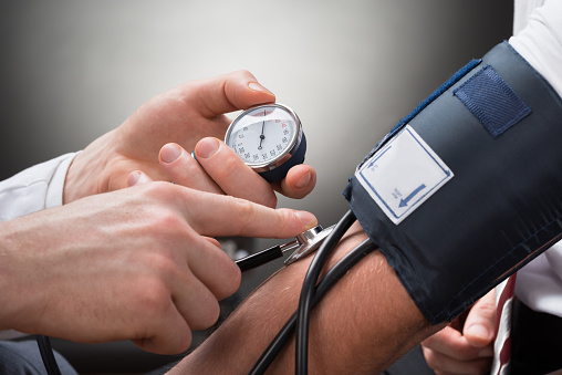 Doctor Checking Blood Pressure Of A Patient 521202902
