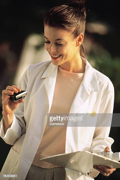 Doctor checking her pager