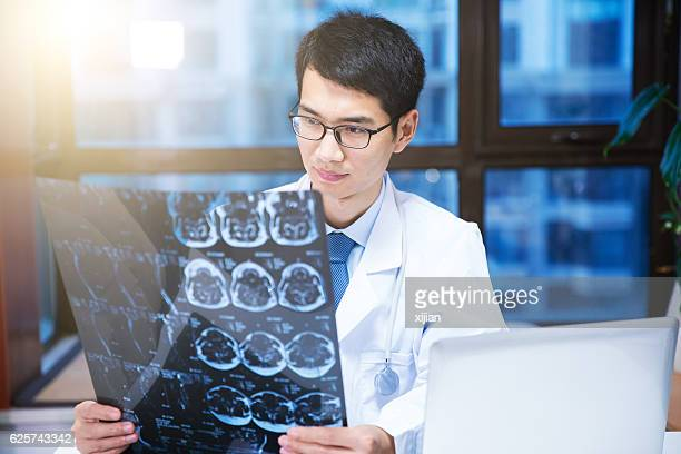Doctor checking magnetic resonance image (MRI)  photo