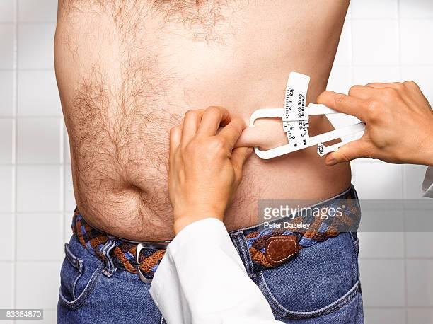 Doctor checking man's BMI