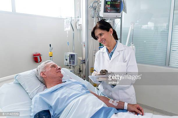 Doctor checking on a patient at the ICU