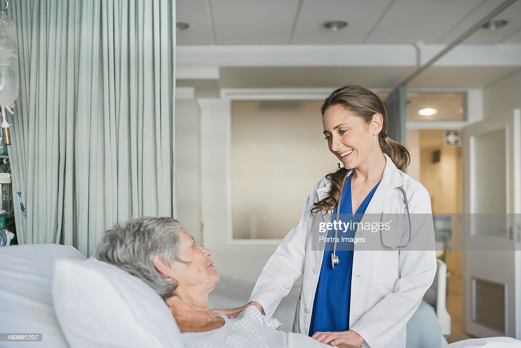 Doctor checking on a patient : Stock Photo