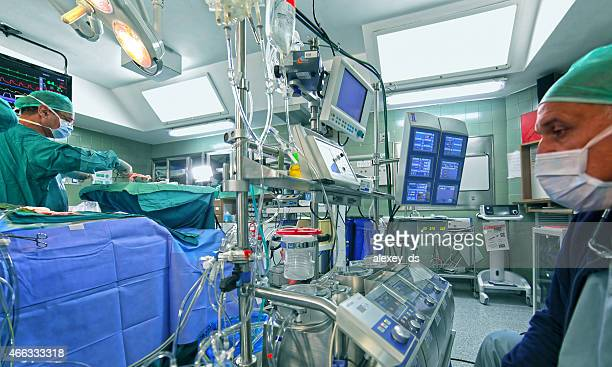 Doctor checking out data of cardiopulmonary bypass machine